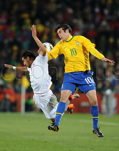 Kaka of Brazil fights for the ball with Arturo Vidal of Chile during the 2010 FIFA World Cup soccer match between Brazil and Chile at Ellis Park Stadium on June 28, 2010 in Johannesburg, South Africa.