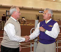 Coach Pat Henry(left) Texas A&M head coach and Coach Dennis Shaver(right) LSU head coach shake hands prior to Texas A&M vs. LSU Dual competetion at Gilliam Indoor-McFerrin Athletic Center on the campus of Texas A&M, College Station on Saturday, January 22, 2011. Photo by Errol Anderson