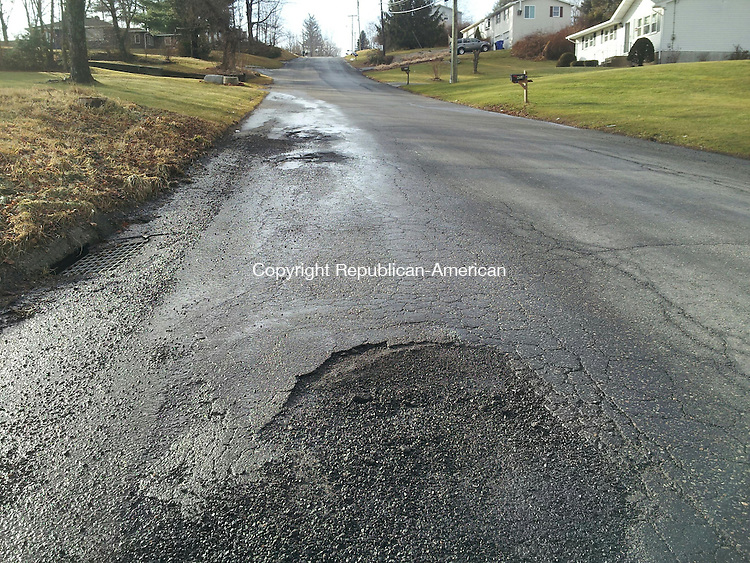 TORRINGTON, CT- 15 January 2014- 011514BJ01-- Pot holes on Highland Avenue in Torrington reveal the damage from the changing temperatures. Public works crews are patching up holes during the brief warm up. Bruno Matarazzo Jr. Republican-American