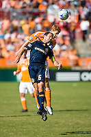 Los Angeles Galaxy midfielder Eddie Lewis (6) and Houston Dynamo defender Andrew Hainault (31) go up for the header. Houston Dynamo tied Los Angeles Galaxy 0-0 at Robertson Stadium in Houston, TX on October 18, 2009.