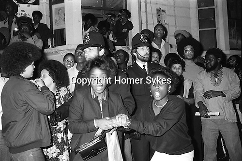 Notting Hill Carnival riot 1979 London UK. Police raid a private house in  All Saints Road, and move all the people from it...