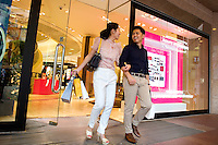 HONG KONG - MAY 04: Patricia Szeto and Jonathan Lui exit a shopping mall in Times Square, on May 4, in Hong Kong. (Photo by Lucas Schifres/Pictobank)