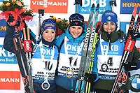 14th March 2020; Kontiolahti, Finland;  Second placed Selina Gasparin of Switzerland, winner Julia Simon of France and third placed Lisa Vittozzi of Italy celebrate on podium after for womens 10 km Pursuit competition at the IBU Biathlon World Cup