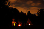 Lakota Tipi glow and campfire at night at Wisconsin Artist Ride