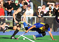 Malaysia's Muhammad Ahmin Rahim (right) tackles Joel Baker during the international hockey match between the New Zealand Black Sticks and Malaysia at Fitzherbert Park, Palmerston North, New Zealand on Sunday, 9 August 2009. Photo: Dave Lintott / lintottphoto.co.nz