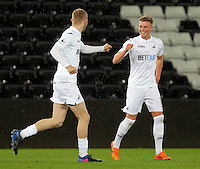 Pictured: Adam King of Swansea (R) celebrates his first goal of his hat trick with Oli McBurnie Tuesday 28 February 2017<br /> Re: Premier League International Cup, Swansea City U23 v Hertha Berlin II at at the Liberty Stadium, Swansea, UK