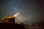 Massive meteor streaks through the sky during the Leonid Meteor shower at Eagle Harbor Lighthouse, Eagle Harbor, MI in the keweenaw peninsula