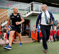 Broncos head coach Andrew Henderson (R) and Danny Ward enter the field during the Kingstone Press Championship game between London Broncos and Oldham Roughyeds at Ealing Trailfinders, Ealing, on Sun June 19, 2016