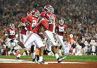 Jan 7, 2010; Pasadena, CA, USA; Alabama Crimson Tide defensive lineman Marcell Dareus (57) celebrates with teammates after returning an interception for a touchdown during the second quarter of the 2010 BCS national championship game against the Texas Longhorns at the Rose Bowl.  Mandatory Credit: Mark J. Rebilas-