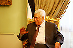 """Palestinian president Mahmud Abbas speaks during a meeting with Hamas chief Khaled Meshaal and other top Fatah and Hamas officials in Cairo on November 24, 2011. Abbas and Meshaal hailed a new Palestinian """"partnership"""" after talks to implement a landmark reconciliation deal. Photo by Ashraf Amra"""