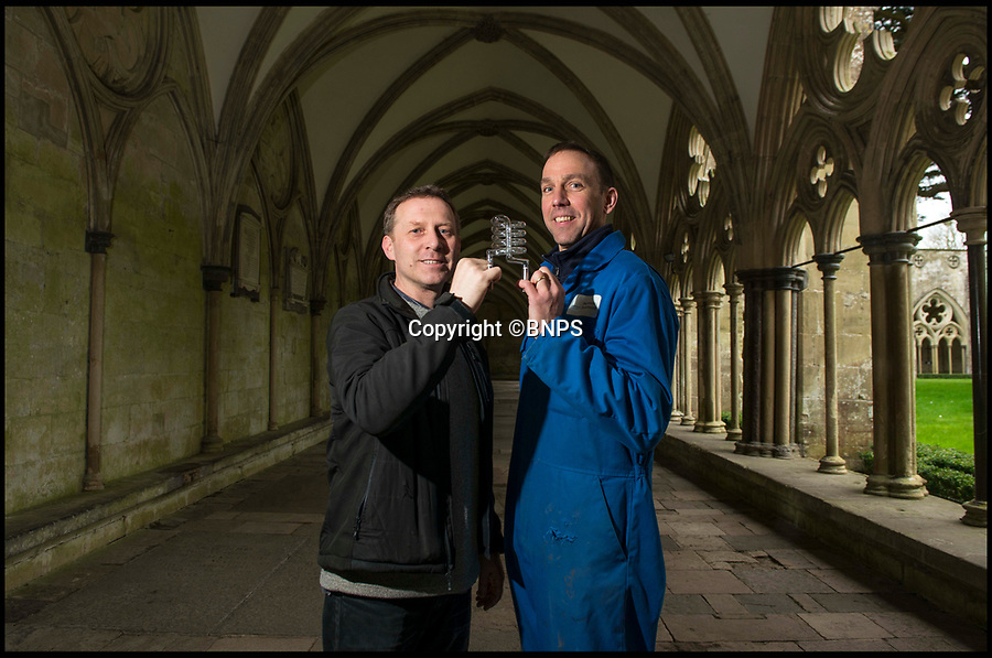 BNPS.co.uk (01202 558833)<br /> Pic: TomWren/BNPS<br /> <br /> Clerk of the Works, Gary Price (left) with Ecclesiastical carpenter Richard Pike and one of the fragile lightbulbs.<br /> <br /> How many men does it take to change a lightbulb... at the top of Britain's tallest spire.<br /> <br /> When your office is Salisbury Cathedral the simple task of changing a light bulb involves four men, a 404ft climb and takes three hours.<br /> <br /> Ecclesiastical carpenter Richard Pike needed a head for heights when he joined Gary Price, who is in charge of conservation, to make the daring ascent with two rope specialists to ensure their safety. <br /> <br /> Despite working at the cathedral for 27 years, it was the first time Richard has ever made the hair-raising climb.