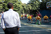 Washington, DC - October 8, 2009 -- United States President Barack Obama watches as members of the National Naval Medical Center Marine Wounded Warrior basketball team play on the court at the White House, October 8, 2009..Mandatory Credit: Pete Souza - White House via CNP