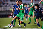 Annaorazov Serdar of Turkmenistan (L) runs with the ball during the AFC Asian Cup UAE 2019 Group F match between Japan (JPN) and Turkmenistan (TKM) at Al Nahyan Stadium on 09 January 2019 in Abu Dhabi, United Arab Emirates. Photo by Marcio Rodrigo Machado / Power Sport Images