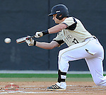 Left fielder James Plaisted (37) of the Wofford College Terriers bunts for a single in the first inning of a game against the Clemson Tigers on Tuesday, May 5, 2015, at Russell C. King Field in Spartanburg, South Carolina. Wofford won, 17-9. (Tom Priddy/Four Seam Images)