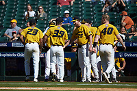 Missouri Tigers relief pitcher Lukas Veinbergs (39) is congratulated by teammates as he walks off the field during the game against the Oklahoma Sooners in game four of the 2020 Shriners Hospitals for Children College Classic at Minute Maid Park on February 29, 2020 in Houston, Texas. The Tigers defeated the Sooners 8-7. (Brian Westerholt/Four Seam Images)