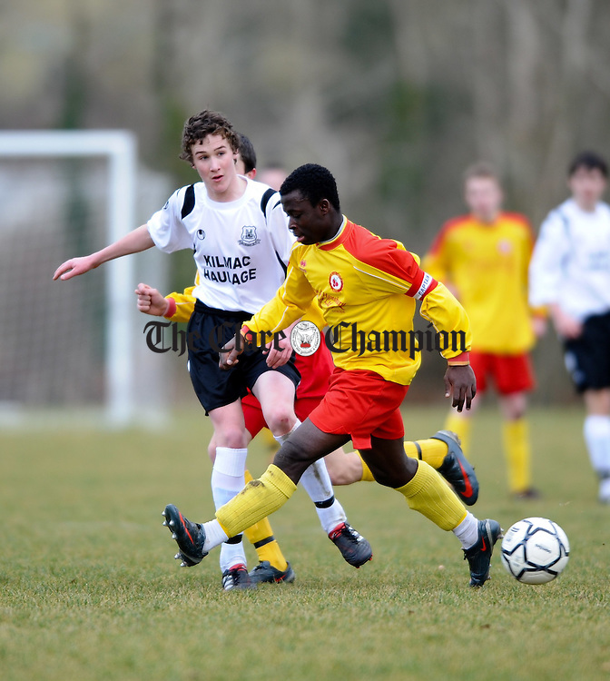 Aidan Sweeney of Kilmacrennan gets the ball past Avenue's Nicholas Twumasi during their U-14 National Cup game at Lees Road. Photograph by John Kelly.