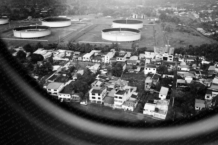 Petroecuador oil Tanks are seen from a airplain in the city of Lago Agrio,founded in the 1960s as a base camp of Texaco, located in the Amazonian forest, The area around the city, the Lago Agrio oil field, has many ecological problems. The rainforest has been all but obliterated in this region and environmental degradation is severe, with catastrophic oil pollution in some areas. On February 14 2011, a judge in Lago Agrio ruled that Chevron, now owner of Texaco, had to pay $9 billion in environmental damages for polluting the rainforest, in an unprecedented environmental ruling.