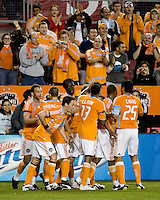 Houston Dynamo players Brad Davis (11), Wade Barrett (24), Richard Mulrooney (8),  Kei Kamara (10), Ricardo Clark (13),  Julius James (3), and Brian Ching (25) celebrate a goal.  Houston Dynamo tied Atlante FC 1-1 at Robertson Stadium in Houston, TX on February 24, 2009 in CONCACAF Champions League play .  Photo by Wendy Larsen/isiphotos.com