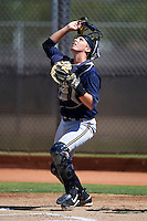 Milwaukee Brewers minor league catcher Paul Eshleman #14 during an instructional league game against the Cincinnati Reds at Maryvale Baseball Park on October 3, 2012 in Phoenix, Arizona.  (Mike Janes/Four Seam Images)
