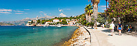 Panoramic photo of Lopud Island waterfront and the Franciscan Monastery, Elaphiti Islands, Dalmatian Coast, Croatia. This panoramic photo shows Lopud Island waterfront and the Franciscan Monastery in the Elaphiti Islands archipelago. The Elaphiti Islands are a small archipelago in Croatia and can be visited by a ferry from Dubrovnik across the Adriatic Sea. For its quiet waterfront, quaint monastery and the inviting, blue, crystal clear Adriatic Sea, visiting Lopud Island, one of the three main islands in the Elaphiti Islands makes for a fantastic day trip from Dubrovnik. Lopud is the second largest Elaphiti Island, and the waterfront cafes, Franciscan Monastery and Sunj Beach (a sandy beach on the south side of Lopud Island), most tourists find it the best Elaphiti Island to visit.