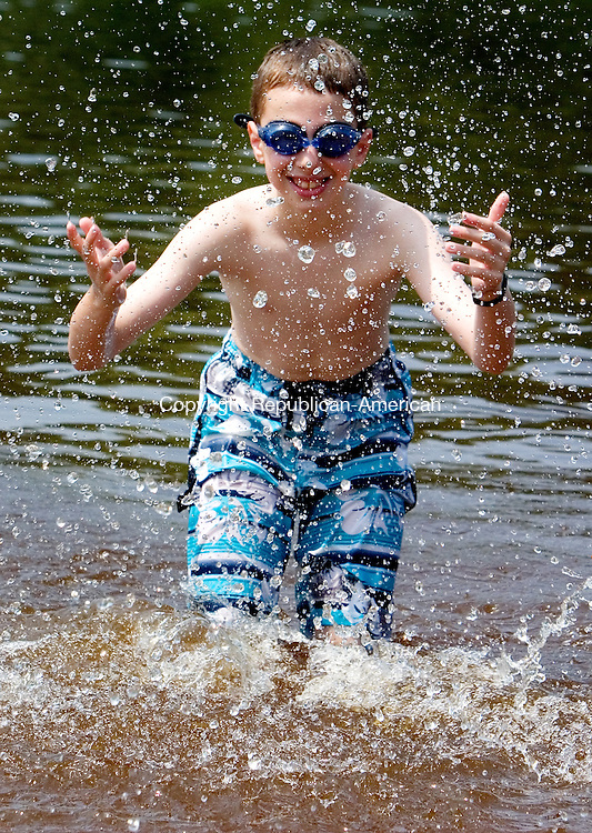 WOLCOTT, CT. 07 July 2010-070710SV04--Matthew Iasevola, 9, of Wolcott enjoys a cool dip in the water at the Woodtick Recreation area in Wolcott Wednesday. <br /> Steven Valenti Republican-American