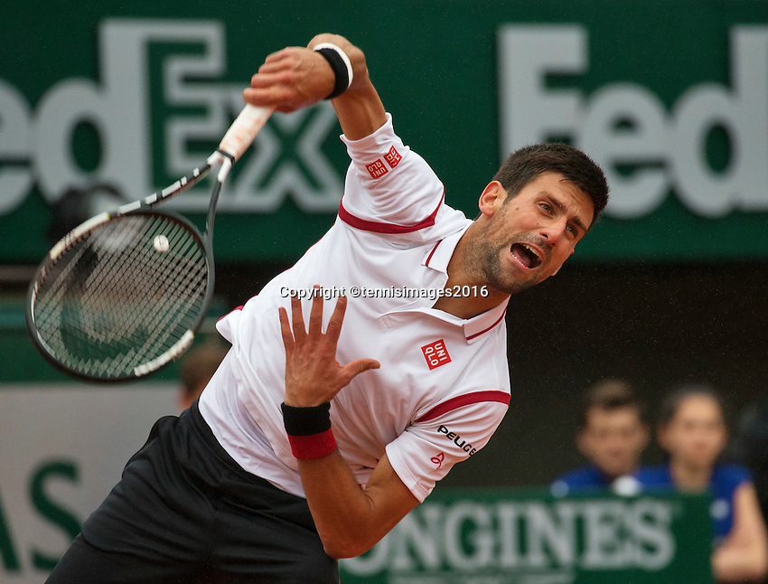 Paris, France, 31 June, 2016, Tennis, Roland Garros, Novak Djokovic (SRB) serves the ball <br /> Photo: Henk Koster/tennisimages.com