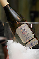 Bottles in ice bucket. Philippe Sivault, Cuvee Louis 2007, Jasnieres, Loire, France