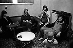"Paul and Linda McCartney  Wings Tour 1975. Linda makes a face at JoJo Laines child who is traveling with them. Jimmy McCulloch on the left, Linda and Colin Allen, an English Blues drummer and member of Stone the Crows. Manchester England. I was on tour with Wings for a children's book ""Facts about a Pop Group Featuring Wings."" Introduced by Paul McCartney, published by G.Whizzard. They had recently recorded albums, Wildlife, Red Rose Speedway, Band on the Run and Venus and Mars. I believe it was the English leg of Wings Over the World tour. But as I recall they were promoting,  Band on the Run and Venus and Mars in particular."