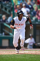 Rochester Red Wings center fielder Eddie Rosario (1) runs to first during a game against the Toledo Mudhens on June 12, 2016 at Frontier Field in Rochester, New York.  Rochester defeated Toledo 9-7.  (Mike Janes/Four Seam Images)