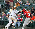 SIOUX FALLS, SD - JULY 30:  Marcos Rodriguez #14 from the Sioux Falls Canaries stretches to get the ball as Cam Kneeland #13 from Trois-Rivieres reaches first safely in the fourth inning Tuesday night at the Sioux Falls Stadium.  (Photo by Dave Eggen/Inertia)