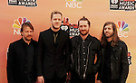 LOS ANGELES, CA- MAY 01: (L-R) Musicians Ben McKee, Dan Reynolds, Daniel Platzman and Wayne Sermon of Imagine Dragons attend the 2014 iHeartRadio Music Awards held at The Shrine Auditorium on May 1, 2014 in Los Angeles, California.