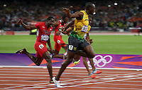05.08.2012. Londion, England.  Jamaica's Usain Bolt crosses the finish line to win gold in the Men's 100m final during the London 2012 Olympic Games Athletics, Track and Field events at the Olympic Stadium, London, Great Britain, 05 August 2012.