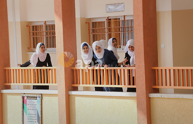 Palestinian schoolgirls return back to their school in the morning of the first day of the new year study, in Gaza city, on August 28, 2016. Photo by Mohammed Asad