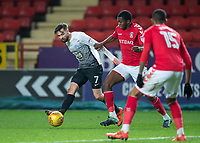 Gwion Edwards of Peterborough United battles with Anfernee Dijksteel of Charlton Athletic during the Sky Bet League 1 match between Charlton Athletic and Peterborough at The Valley, London, England on 28 November 2017. Photo by Vince  Mignott / PRiME Media Images.