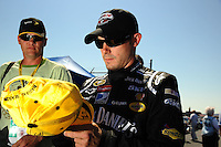 Apr 25, 2009; Talladega, AL, USA; NASCAR Sprint Cup Series driver Casey Mears signs autographs during qualifying for the Aarons 499 at Talladega Superspeedway. Mandatory Credit: Mark J. Rebilas-