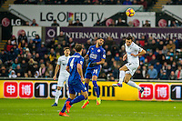 Jack Cork of Swansea City ( right) jumps for the ball during the Premier League match between Swansea City and Leicester City at The Liberty Stadium, Swansea, Wales, UK. Sunday 12 February 2017