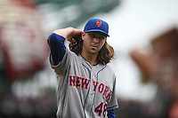 SAN FRANCISCO, CA - JULY 8:  Jacob deGrom of the New York Mets walks off the field against the San Francisco Giants during the game at AT&T Park on Wednesday, July 8, 2015 in San Francisco, California. (Photo by Brad Mangin)