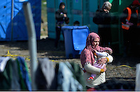 Pictured: A migrant mother with her young baby in the camp Tuesday 01 March 2016<br /> Re: Thousands of migrants, still stranded at the Greek FYRO Macedonian border in Idomeni, Greece