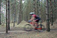 07 APR 2007 - THETFORD, UK - A competitor speeds along a singletrack section during round 1 of the British Mountain Bike X Country series. (PHOTO (C) NIGEL FARROW)
