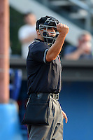 Umpire Derek Moccia during a NY-Penn League game between the Batavia Muckdogs and Mahoning Valley Scrappers on June 22, 2013 at Dwyer Stadium in Batavia, New York.  Batavia defeated Mahoning Valley 2-1 in ten innings.  (Mike Janes/Four Seam Images)