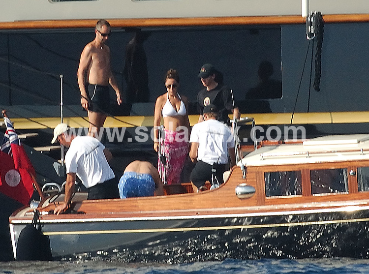 **ALL ROUND PICTURES FROM SOLARPIX.COM**.**WORLDWIDE SYNDICATION RIGHTS EXCLUDING SPAIN - NO PUBLICATION IN SPAIN**.Formula One boss and Italian businessman Flavio Briatore and his recent new wife Elisabetta Gregaoraci headed over to the Spanish island of Ibiza this week, for a relaxing getaway with some family and friends including Alejandro Agag and Ana Aznar. ..This pic:..JOB REF: 7117 MAD       DATE: 25_08_2008.**MUST CREDIT SOLARPIX.COM OR DOUBLE FEE WILL BE CHARGED* *UNDER NO CIRCUMSTANCES IS THIS IMAGE TO BE REPRODUCED FOR ANY ONLINE EDITION WITHOUT PRIOR PERMISSION*
