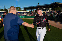 Batavia Muckdogs Troy Johnston (27) shakes hands with Booster Club President Hal Mitchell during a pre-game awards ceremony before a NY-Penn League game against the Auburn Doubledays on August 31, 2019 at Dwyer Stadium in Batavia, New York.  Auburn defeated Batavia 12-5.  (Mike Janes/Four Seam Images)