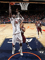 CHARLOTTESVILLE, VA- December 27: Assane Sene #5 of the Virginia Cavaliers shoots in front of Hillary Haley #24 of the Maryland-Eastern Shore Hawks during the game on December 27, 2011 at the John Paul Jones Arena in Charlottesville, Va. Virginia defeated Maryland Eastern Shore 69-42.  (Photo by Andrew Shurtleff/Getty Images) *** Local Caption *** Hillary Haley;Assane Sene