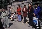 Beijing China 1990s Unemployed out of work men and women wait at unofficial daily job market to be selected for possible work 1995