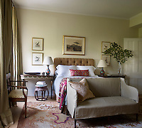 One of the guest bedrooms, furnished with antique pieces and soft furnishings