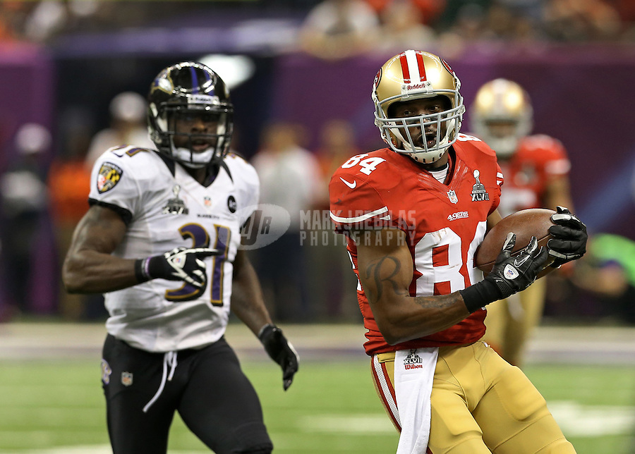 Feb 3, 2013; New Orleans, LA, USA; San Francisco 49ers wide receiver Randy Moss (84) catches a pass in front of Baltimore Ravens safety Bernard Pollard (31) in Super Bowl XLVII at the Mercedes-Benz Superdome. Mandatory Credit: Mark J. Rebilas-