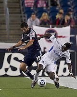 New England Revolution midfielder Monsef Zerka (19) and San Jose Earthquakes midfielder Simon Dawkins (10) battle for the ball. In a Major League Soccer (MLS) match, the San Jose Earthquakes defeated the New England Revolution, 2-1, at Gillette Stadium on October 8, 2011.