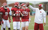 NWA Democrat-Gazette/ANDY SHUPE<br /> Arkansas receivers coach Michael Smith (right) works Tuesday, Aug. 1, 2017, with receivers Kofi Boateng (17) ad River Warnock during practice at the university's practice field in Fayetteville. Visit nwadg.com/photos to see more photographs from the day's practice.