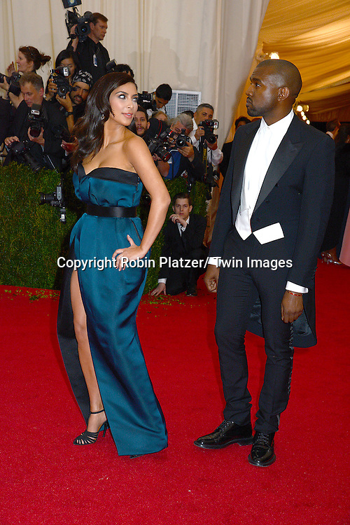 Kim Kardashian and Kanye West attend the Costume Institute Benefit on May 5, 2014 at the Metropolitan Museum of Art in New York City, NY, USA. The gala celebrated the opening of Charles James: Beyond Fashion and the new Anna Wintour Costume Center.