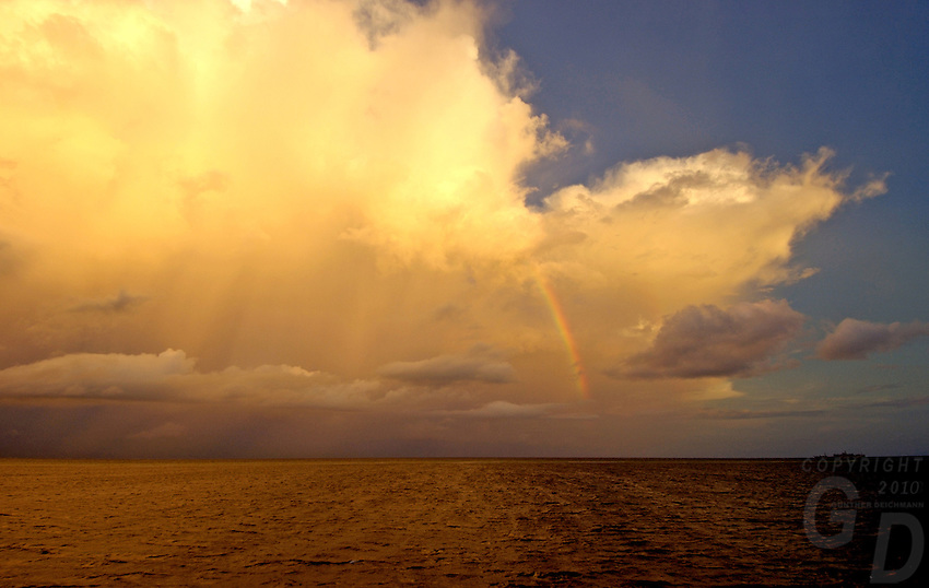 Rainstorm over a small reef in the Pacific, between Chuuk and Pohnpei, Micronesia